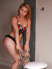 Shemale hottie plays with shecock in pool