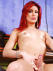 Exotic redhead femboy shows off delicious body