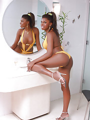 Chocolate beauty Valeria posing in the bathroom