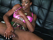 Horny black shemale jerking off her cock into a container