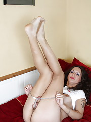 Gorgeous transsexual Nikki stripping and posing