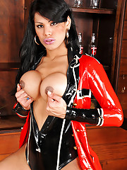 Busty shemale babe in red and black latex