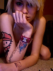 Blonde emo chick posing topless