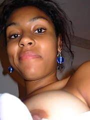 Hot ebony teen shows off her titties for the camera