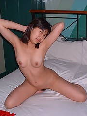 Pictures of an Asian chick posing in a motel