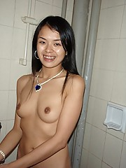 A cute Asian honey gets naked and gives a handjob