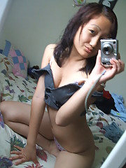 Cute Asian selfshooter with a sexy body plays with the camera in her room