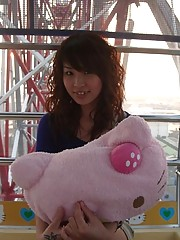 Innocent teen stripping on a Hello Kitty ferris wheel