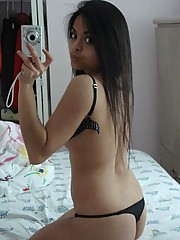 Cute mixed race Asian teen taking selfpics