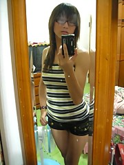 Chinese chick with glasses posing for selfpics