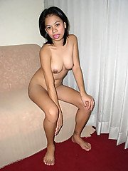 Filipina gets naked and spreads her legs wide