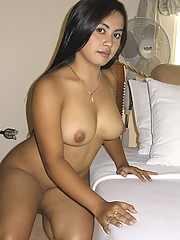 Voluptuous Asian posing naked