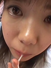 Cute Asian with huge eyes sucking dick