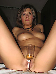 Pictures of a naked MILF playing with a hard cock