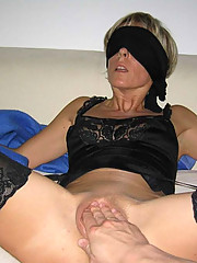 Pictures of a blindfolded MILF in a wild sex party