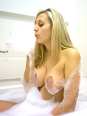 Pictures of a tattooed housewife posing and sucking cock