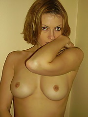 Photos of a naughty wife in lingerie posing for her hubby
