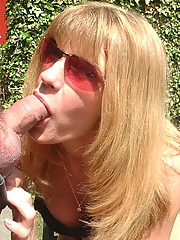 MILF sucking cock outdoors