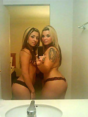 Sexy Latina with highlights in her hair and her friend selfshooting