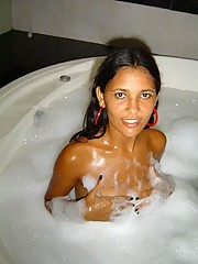 A naked Latina chick in bed and in the bathtub