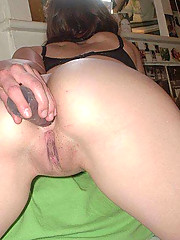 Pictures of naughty chicks sticking a dildo up their ass
