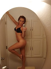 Photos of a naked sexy girl posing in her flat