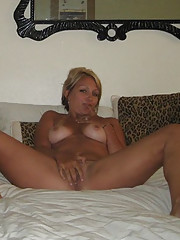 Pictures of a naked blonde naked in her bedroom