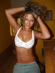 Hot curly blonde shows off her bouncy tits