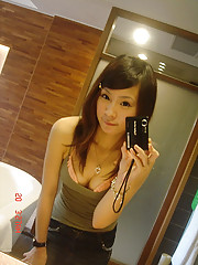 Cute Asian chicks posing sexy