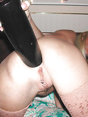 Kinky blonde stuffs a ginormous dildo up her ass