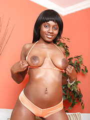 Mary J. Rides was looking to get a mouthful of cock.  We asked her to pull her panties down to show us that delightful little chocolate twat and her cute little round ass before she bared her breasts, leaned over our crotch, and gave us a blowjob to remem