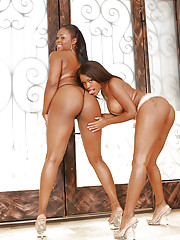 When their boyfriends are out of town, Brown Suga and Candice Nicole get downright freaky, working their pussies together and having naughty lesbian sex.  See them spreading those thick booties for each other