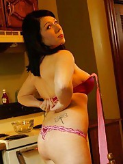 Curvy chick half-naked in the kitchen