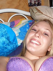 smiling blonde girl goes topless and keeps smiling