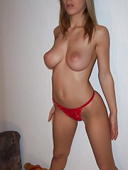 beautiful brunette topless showing off her perfect natural tits