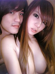 homemade pictures of a cute asian couple a little yellowy tho