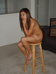 very pretty asian teen posing nude but looks disinterested