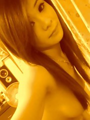 hotttt cute girl takes topless pics but uses her beautiful hair to cover her nips