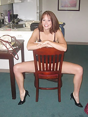 Photos of a kinky MILF displaying her pussy