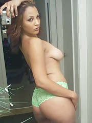 Picture collection of a topless curvy tattooed MILF