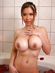 Photo gallery of an amateur heavy-chested babe in a bath tub