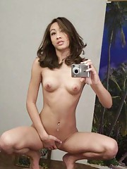 Picture gallery of an amateur naked Asian hottie camwhoring