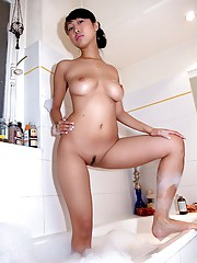Photo gallery of a naked Asian hottie giving a BJ