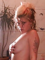 Photo collection of a steamy hot tattooed chick in the showers