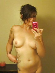 Photo collection of a hot tattooed GF with body piercings