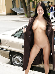 Busty babe shows she's got nothing under her coat