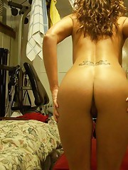 Picture set of a tattooed chick showing her nice ass