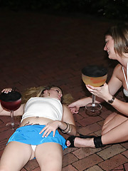 2 horny babes outside of a club fall to the floor drunk and fuck one another