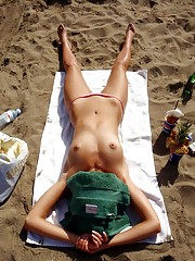 Collection of a kinky MILF posing topless at a beach