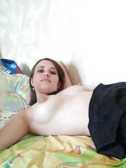 Collection of a sexy brunette MILF posing on her bed